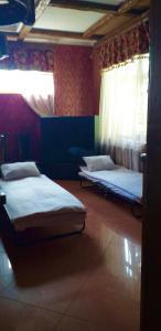 Кровать или кровати в номере Inn Usad'ba Ust'-Boyarskoe