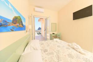 A bed or beds in a room at Albergo Atlantic
