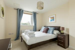 A bed or beds in a room at Bay Retreat