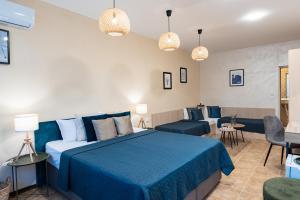 Posteľ alebo postele v izbe v ubytovaní Sunrise Hotel