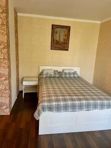 Кровать или кровати в номере Квартира Екатерины