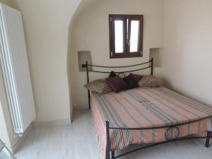 A bed or beds in a room at Affittacamere Il Rudere