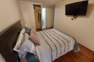 A bed or beds in a room at Apartment deluxe , con vista al mar, San Miguel