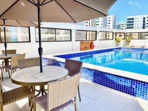 The swimming pool at or near Kastel Manibu Recife - Boa Viagem