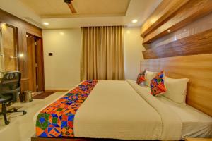A bed or beds in a room at FabHotel Golden Swan Airport