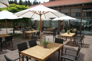 A restaurant or other place to eat at Waldhotel Berghof