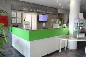 The lobby or reception area at H+ Hotel Erfurt