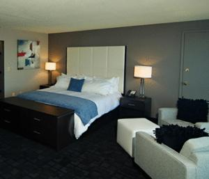 A bed or beds in a room at Oyster Point Hotel
