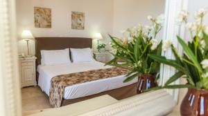 A bed or beds in a room at Hotel Astron Princess