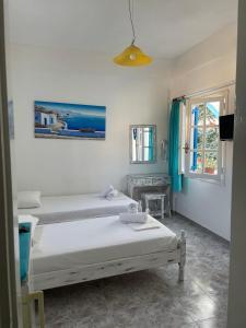 Un ou plusieurs lits dans un hébergement de l'établissement Anna Maria Rooms Santorini