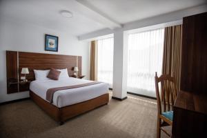 A bed or beds in a room at Conde de Lemos Hotel