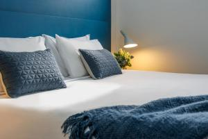 A bed or beds in a room at Quest Geelong