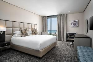 A bed or beds in a room at Premier Hotel Umhlanga