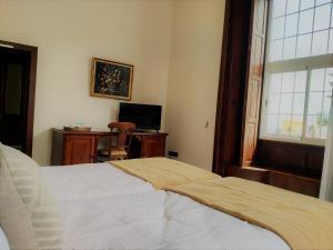 Cama o camas de una habitación en Hotel Rural Victoria