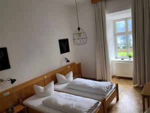 A bed or beds in a room at Maria Waldrast