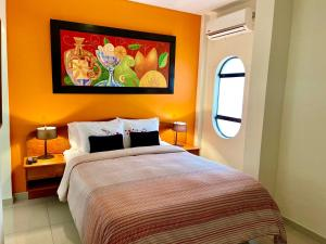 A bed or beds in a room at Peru Star Apart-Hotel