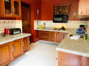 A kitchen or kitchenette at Peru Star Apart-Hotel
