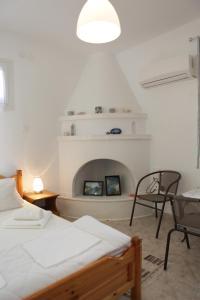 Ένα ή περισσότερα κρεβάτια σε δωμάτιο στο O Pyrgos Accommodations