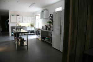 A kitchen or kitchenette at Nexø Modern Hostel. Private Rooms