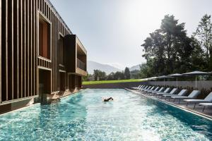 The swimming pool at or near Falkensteiner Hotel Kronplatz - Adults only