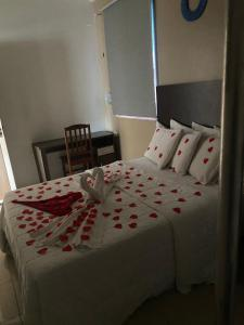 A bed or beds in a room at Hotel Mapuera