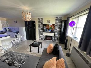 A seating area at WindyS Basildon Smart Home