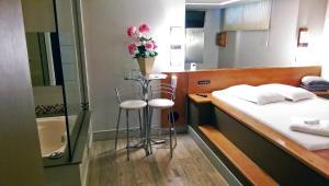 Um banheiro em Motel Cisne Blumenau (Adult Only)