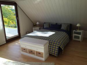 Ein Bett oder Betten in einem Zimmer der Unterkunft Ferienwohnung Alexandra