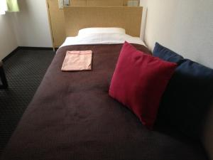 A bed or beds in a room at Nagano Plaza Hotel