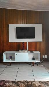 A television and/or entertainment center at Residencial P. Harris