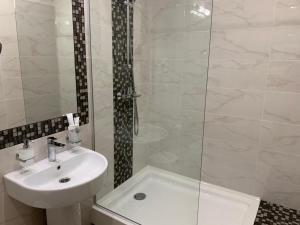 Ванная комната в Aura Hotel & Spa