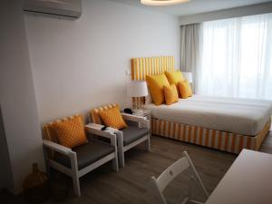 A bed or beds in a room at Hotel HS Milfontes Beach - Duna Parque Hotel Group