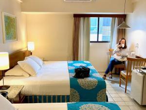 A bed or beds in a room at Kastel Manibu Recife - Boa Viagem