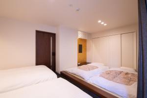 Hotel Celeste Shizuokaにあるベッド