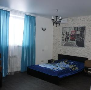 Кровать или кровати в номере Райская Лагуна Омск