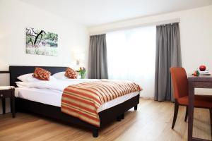 سرير أو أسرّة في غرفة في شقق سيتي ستاي المفروشة - كيسيلغاسي
