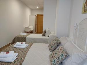 A bed or beds in a room at Lar do Peregrino