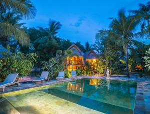 The swimming pool at or near Sukanusa Luxury Huts