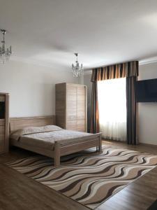 """Кровать или кровати в номере """"Апартаменты у Елены-1"""""""