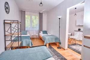 Łóżko lub łóżka w pokoju w obiekcie Dom Wypoczynkowy LAGUNA Gąski