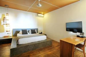 A bed or beds in a room at Clio Apartment