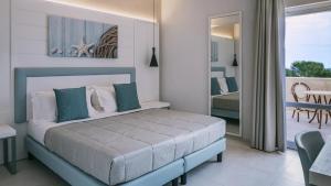Letto o letti in una camera di Pollina Premium Resort