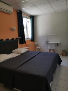 Un ou plusieurs lits dans un hébergement de l'établissement Carry Hotel