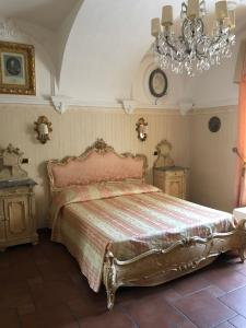 A bed or beds in a room at Ai Savoia