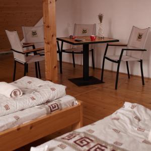 Ліжко або ліжка в номері U Dvori
