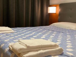 Letto o letti in una camera di Hotel Riviera