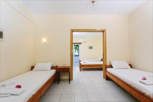Ένα ή περισσότερα κρεβάτια σε δωμάτιο στο Hotel Loula Rooms and Apartments