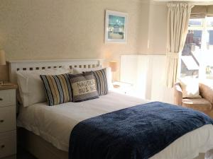 A bed or beds in a room at South View Guest House