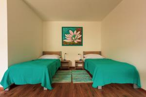 A bed or beds in a room at Apartmany Tereza