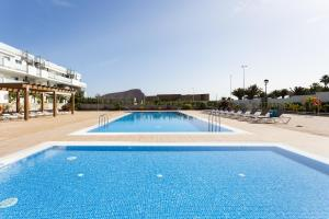 The swimming pool at or near 101 SOTAVENTO FOREST by SUNKEYRENTS
